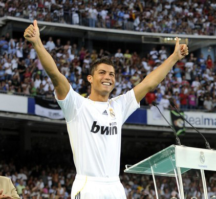 Real Madrid's new player Portuguese Cristiano Ronaldo (R) waves to supporters next to former football player Portuguese Eusebio during his official presentation at the Santiago Bernabeu stadium in Madrid on July 6, 2009. Real acquired the 24-year-old Portuguese striker from Manchester United last month on a six-year deal worth 94 million euros (131 million dollars) and Spanish media reports that he will be paid 13 million euros each season. AFP PHOTO / DANI POZO (Photo credit should read Dani Pozo/AFP/Getty Images)